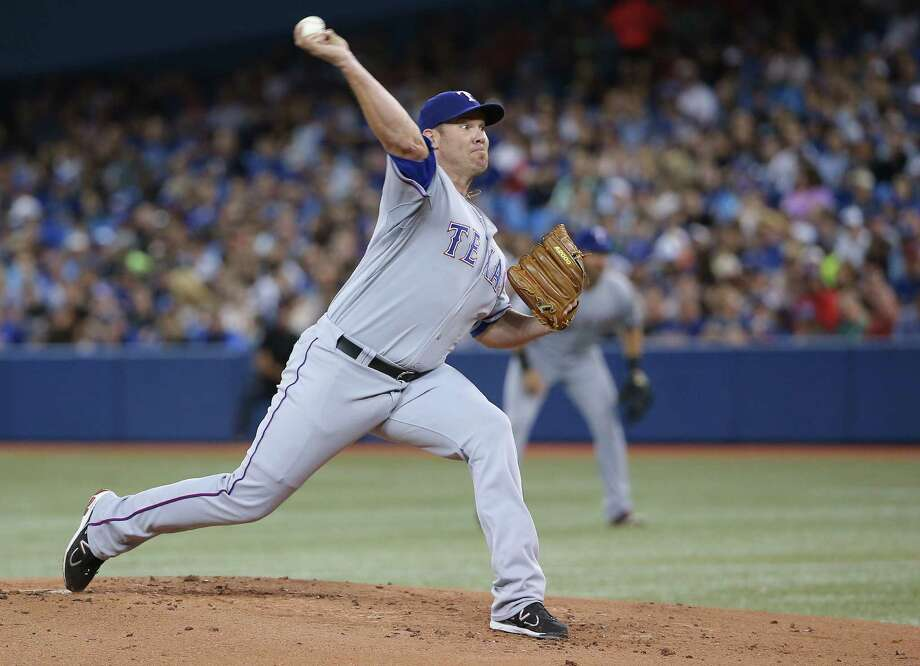 "Colby Lewis, delivering a pitch during the first inning for Texas at Toronto, lost his second straight start for the first time this season. ""I felt like my stuff was great,"" Lewis said. Photo: Tom Szczerbowski / Getty Images / 2014 Getty Images"