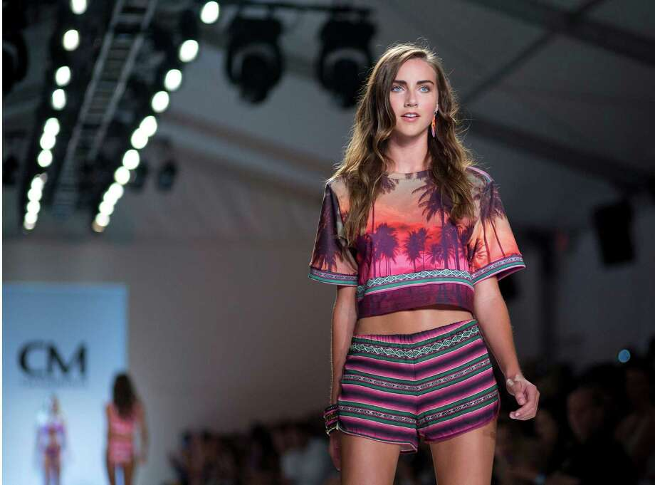 A model walks down the runway wearing swimwear from the CM Cia Maritima collection during the Mercedes-Benz Fashion Week Swim show, Saturday, July 19, 2014, in Miami Beach, Fla. Photo: J Pat Carter, AP / AP