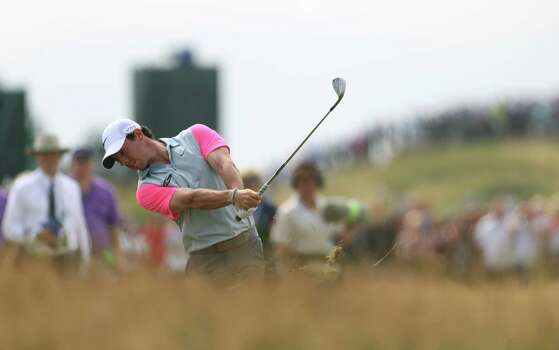 Rory McIlroy of Northern Ireland plays from the rough on the 7th fairway during the final round of the British Open Golf championship at the Royal Liverpool golf club, Hoylake, England, Sunday July 20, 2014. (AP Photo/Peter Morrison) Photo: Peter Morrison, Associated Press / AP