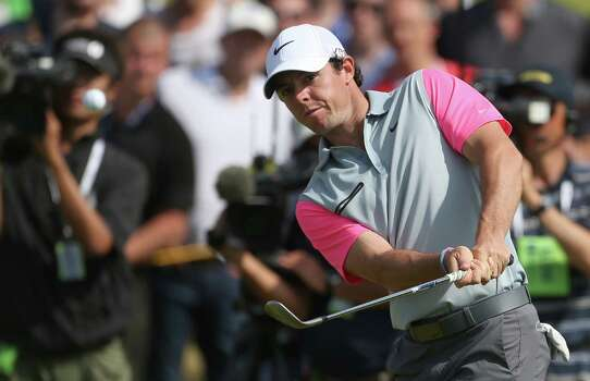 Rory McIlroy of Northern Ireland chips onto the 6th green during the final round of the British Open Golf championship at the Royal Liverpool golf club, Hoylake, England, Sunday July 20, 2014. (AP Photo/Peter Morrison) Photo: Peter Morrison, Associated Press / AP