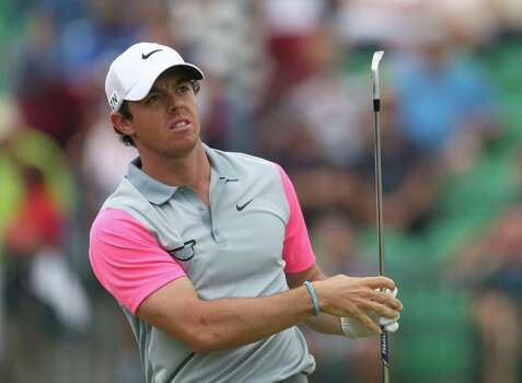 Rory McIlroy of Northern Ireland watches the flight of his shot from the 4th tee during the final round of the British Open Golf championship at the Royal Liverpool golf club, Hoylake, England, Sunday July 20, 2014. (AP Photo/Peter Morrison) Photo: Peter Morrison, Associated Press / AP