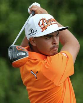 Rickie Fowler of the US plays a tee shot off the 8th hole during the final round of the British Open Golf championship at the Royal Liverpool golf club, Hoylake, England, Sunday July 20, 2014. (AP Photo/Peter Morrison) Photo: Peter Morrison, Associated Press / AP