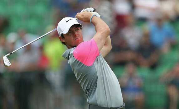 Rory McIlroy of Northern Ireland plays his tee shot from the 4th during the final round of the British Open Golf championship at the Royal Liverpool golf club, Hoylake, England, Sunday July 20, 2014. (AP Photo/Peter Morrison) Photo: Peter Morrison, Associated Press / AP