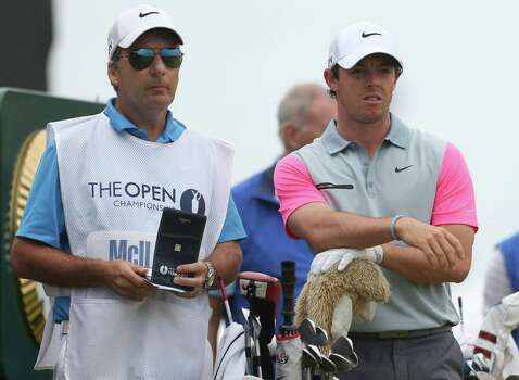 Rory McIlroy of Northern Ireland waits with his caddie JP Fitzgerald to play off the 4th tee during the final round of the British Open Golf championship at the Royal Liverpool golf club, Hoylake, England, Sunday July 20, 2014. (AP Photo/Peter Morrison) Photo: Peter Morrison, Associated Press / AP