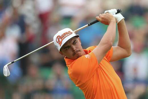 Rickie Fowler of the US plays his shot from the 4th tee during the final round of the British Open Golf championship at the Royal Liverpool golf club, Hoylake, England, Sunday July 20, 2014. (AP Photo/Peter Morrison) Photo: Peter Morrison, Associated Press / AP
