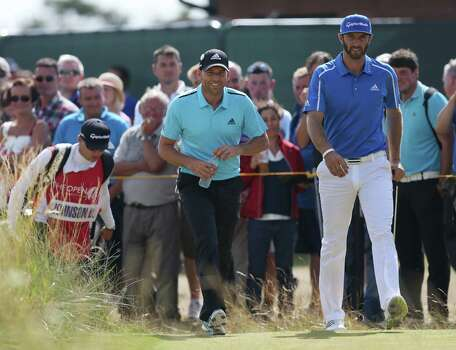 Sergio Garcia of Spain and Dustin Johnson of the US, right, walk to the 7th fairway during the final round of the British Open Golf championship at the Royal Liverpool golf club, Hoylake, England, Sunday July 20, 2014. (AP Photo/Scott Heppell) Photo: Scott Heppell, Associated Press / AP