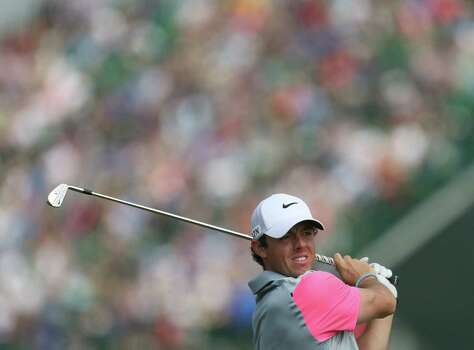 Rory McIlroy of Northern Ireland plays a shot on the 5th hole during the final round of the British Open Golf championship at the Royal Liverpool golf club, Hoylake, England, Sunday July 20, 2014. (AP Photo/Peter Morrison) Photo: Peter Morrison, Associated Press / AP
