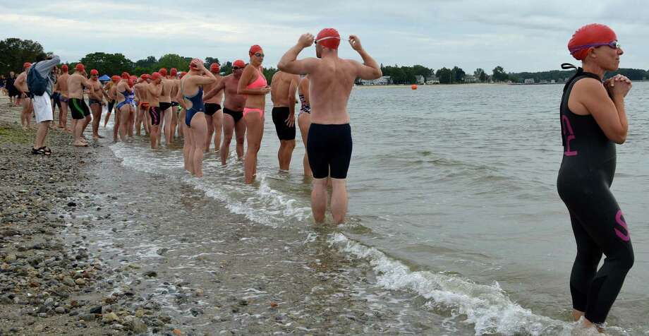 Swimmers primed at water's edge for a heat in the Westport Weston Family Y's 36th annual Point-to-Point swim Sunday morning at Compo Beach. Photo: Jarret Liotta / Westport News