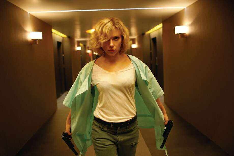 "Scarlett Johansson stars in ""Lucy,"" a sci-fi adventure from Luc Besson, the director of ""The Fifth Element."" It opens on Friday. Photo: Jessica Forde, Universal Pictures / © Universal Pictures"