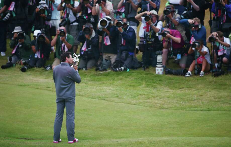 HOYLAKE, ENGLAND - JULY 20:  Rory McIlroy of Northern Ireland kisses the Claret Jug after his two-stroke victory at The 143rd Open Championship at Royal Liverpool on July 20, 2014 in Hoylake, England. Photo: Matthew Lewis, Getty Images / 2014 Getty Images