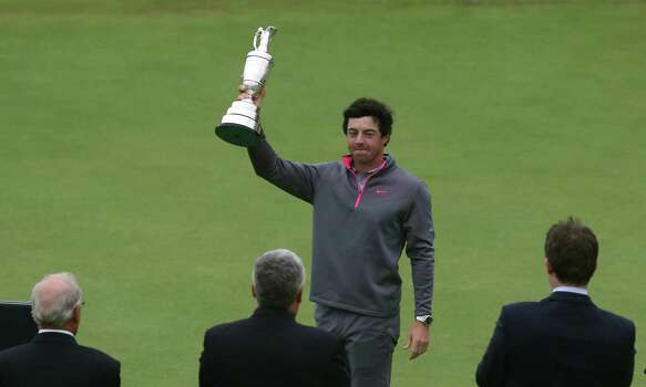 Rory McIlroy of Northern Ireland holds up the  Claret Jug trophy after winning the British Open Golf championship at the Royal Liverpool golf club, Hoylake, England, Sunday July 20, 2014. (AP Photo/Jon Super) Photo: Jon Super, Associated Press / AP