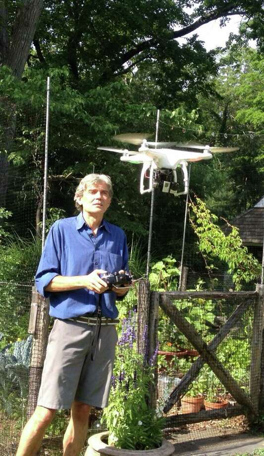 Explorer/environmentalist Luc Hardy does some drone operation practice at his home in Cos Cob. Hardy wants to use the high tech gadget to capture aerial photographs and videos of  his expeditions to help in his research. Photo: Anne Semmes / Greenwich Time