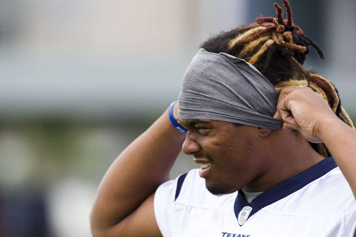 Brennan Williams was part of the Texans' dubious 2013 draft class. Now, he's reportedly going to try his hand at pro wrestling. Click through the gallery to see notable wrestlers who were football players first.