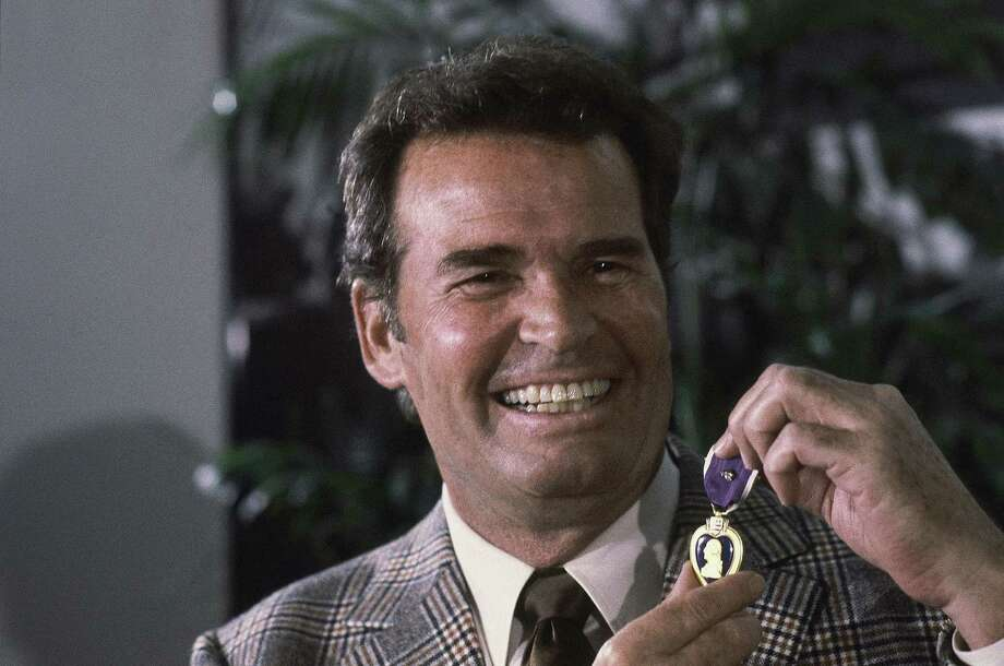 "FILE - Actor James Garner, left, smiles as he holds up the Purple Heart medal presented to him in a ceremony in this Monday, Jan. 24, 1983 file photo taken Los Angeles, Calif. Garner was wounded in April 1951 while with U.S. Forces in Korea, but his medal was never presented to him. Actor James Garner, wisecracking star of TV's ""Maverick"" who went on to a long career on both small and big screen, died Saturday July 19, 2014 according to Los angeles police. He was 86. Photo: Lennox McLendon, AP / AP"