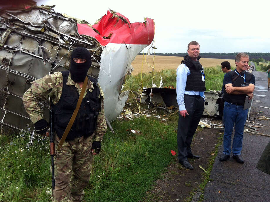 Alexander Hug (2nd L), Deputy Chief Monitor of the Organization for Cooperation and Security in Europe's  (OSCE) Special Monitoring Mission to Ukraine, visits the site of the crash of a Malaysian airliner carrying 298 people from Amsterdam to Kuala Lumpur, near the town of Shaktarsk, in rebel-held east Ukraine, on July 18, 2014. Pro-Russian separatists in the region and officials in Kiev blamed each other for the crash, after the plane was apparently hit by a surface-to-air missile. All 298 people on board Flight MH17 died when the plane crashed. Photo: DOMINIQUE FAGET, Wire Photos / AFP