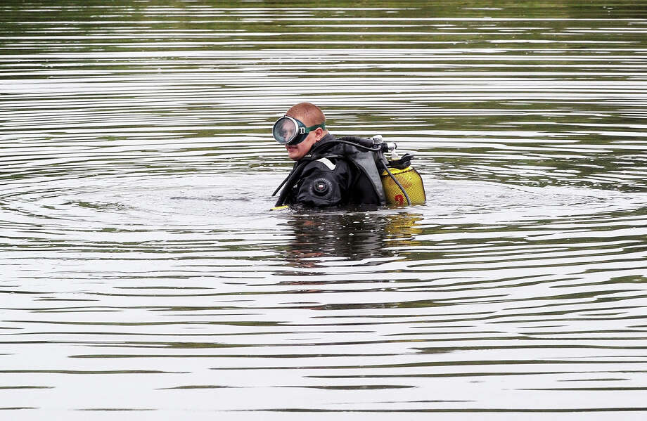 A diver searches for a black box on July 18, 2014 on the site of the crash of a Malaysian airliner carrying 298 people from Amsterdam to Kuala Lumpur, near the town of Shaktarsk, in rebel-held east Ukraine. Pro-Russian separatists in the region and officials in Kiev blamed each other for the crash, after the plane was apparently hit by a surface-to-air missile. All 298 people on board Flight MH17 died when the plane crashed. Photo: DOMINIQUE FAGET, AFP/Getty Images / AFP