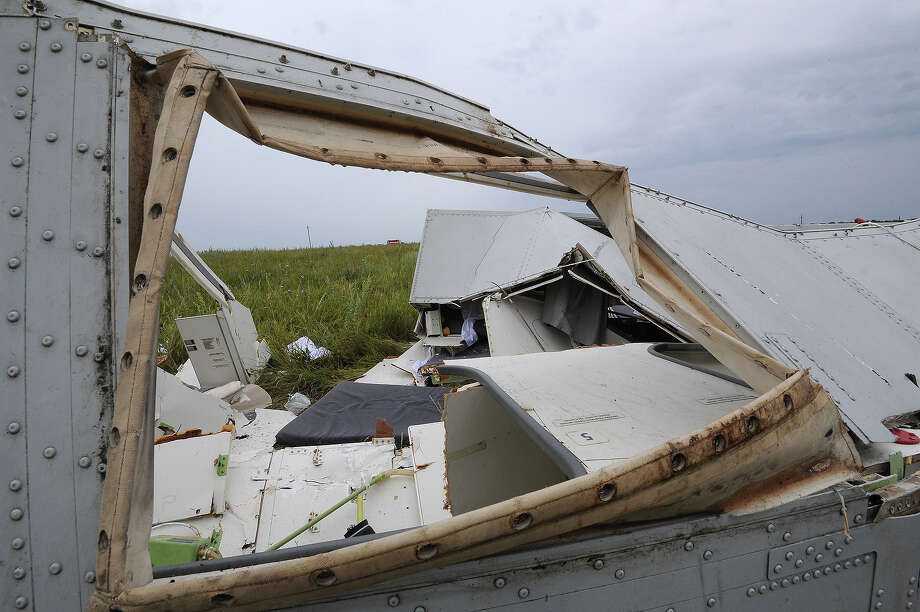 Pieces of wreckage of the Malaysia Airlines flight MH17 are pictured on July 18, 2014 in Shaktarsk, the day after it crashed. Flight MH17 from Amsterdam to Kuala Lumpur, which US officials believe was hit by a surface-to-air missile over Ukraine, killing all 298 people on board. Photo: DOMINIQUE FAGET, AFP/Getty Images / AFP