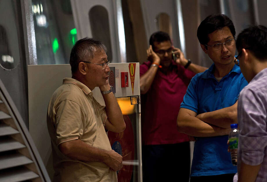 "Relatives of passengers onboard Malaysia Airlines flight MH17 from Amsterdam wait for information outside the family holding area at the Kuala Lumpur International Airport in Sepang on July 18, 2014. Malaysia Airlines said on July 17 that it had ""lost contact"" with one of its passenger planes carrying 295 people over eastern Ukraine, amid speculation it had been shot down. Pro-Russian rebels fighting central Kiev authorities claimed that the Malaysian airline that crashed in Ukraine had been shot down by a Ukrainian jet. The head of Ukraine's air traffic control agency said Thursday that the crew of the Malaysia Airlines jet that crashed in the separatist east had reported no problems during flight. Photo: MANAN VATSYAYANA, Wire Photos / AFP"