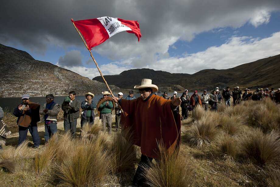 Residents march in a demonstration to protest the Conga gold and silver mining project in Mamacocha Lagoon. Peru's economy depends heavily on mining, which makes up about 60 percent of export income. Photo: Martin Mejia, Associated Press