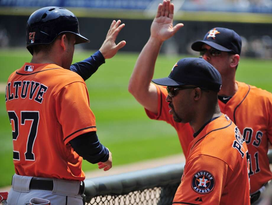July 20: Astros 11, White Sox 7  Jose Altuve is greeted after scoring. Photo: David Banks, Getty Images