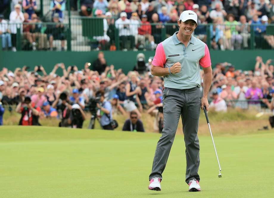 Rory McIlroy clinches the British Open on No. 18, completing a wire-to-wire major victory. Photo: Andrew Redington, Getty Images