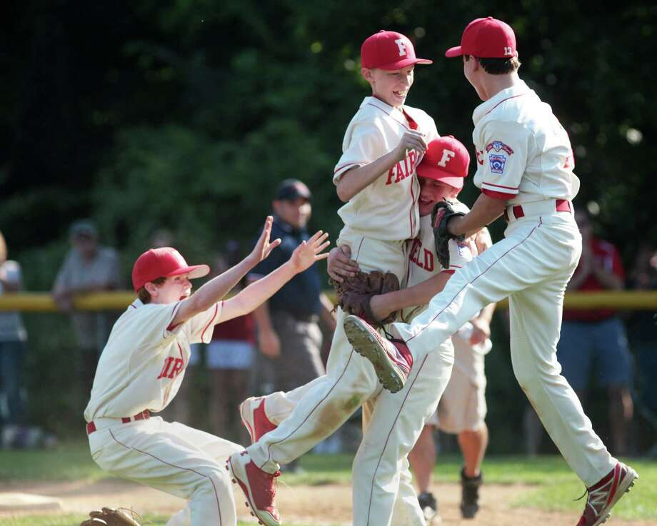 Fairfield American Little League players, from left, Jack Steed, Ian Bentley, Brian Howell, and PJ Egan, celebrate their victory over Norwalk to win the state Section 1 championship game in Orange, Conn. on Sunday, June 20, 2014. Photo: BK Angeletti, B.K. Angeletti / Connecticut Post freelance B.K. Angeletti