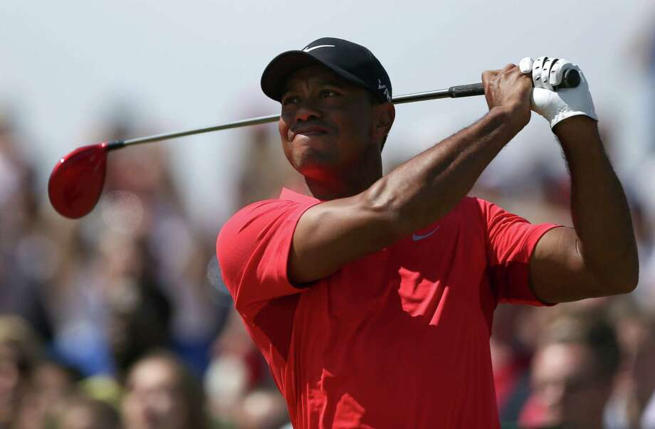 Tiger Woods of the US plays a shot off the 16th tee during the final round of the British Open Golf championship at the Royal Liverpool golf club, Hoylake, England, Sunday July 20, 2014. (AP Photo/Jon Super) ORG XMIT: HOY108 Photo: Jon Super / AP