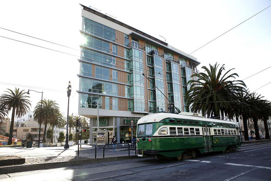 The new 38 Dolores residential building at the corner of Market, above a Whole Foods store, has a knife-like effect. Photo: Michael Short, The Chronicle