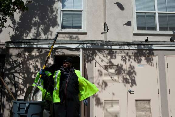 Green Streets co-founder Tyrone Mullins grabs a shovel to sort through compost and recyclables in Hayes Valley in San Francisco, Calif. on Monday, June 16, 2014. The company was created as part of a Stanford program that helps ex-cons start their own businesses.