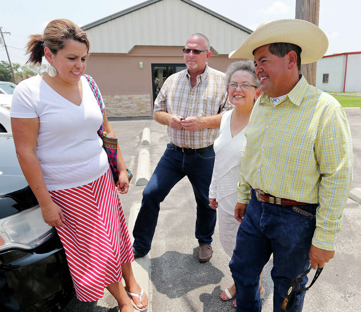 Victoria Rutkowski (from left), and her husband Jimmy, her mother Olga Serna, and brother Steven Serna talk about the undocumented women and children from Central America, Sunday July 20, 2014 outside the First Assembly of God Church in Karnes City, Tx., that are scheduled to be housed at the Karnes County Civil Detention Center. The family opposes the planned housing.