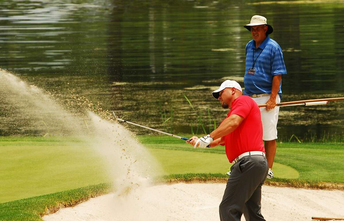 Sebastian Janikowski comes out of the sand on the 6th hole during the Lake Tahoe Visitor Authority Pro Am on July 15, 2014 in Stateline, Nevada.