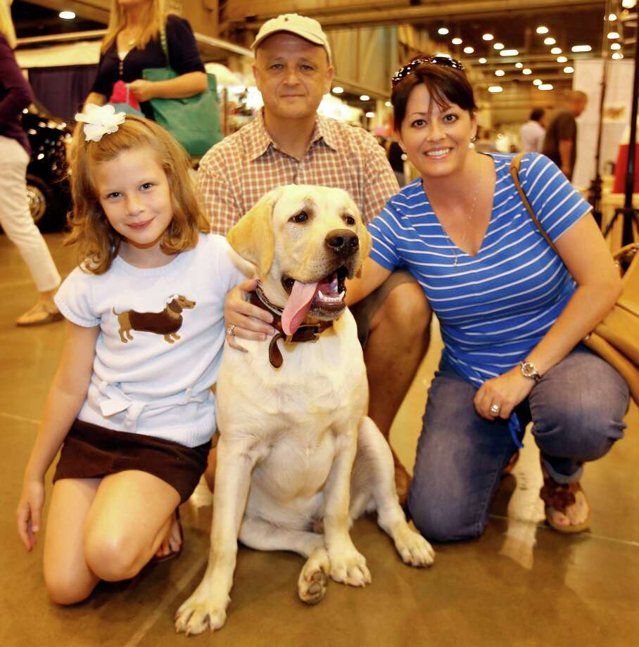 People pose with their dog during the Houston World Series of Dog Shows at NRG Center Sunday, July 20, 2014, in Houston. Photo: Melissa Phillip, Houston Chronicle / © 2014  Houston Chronicle