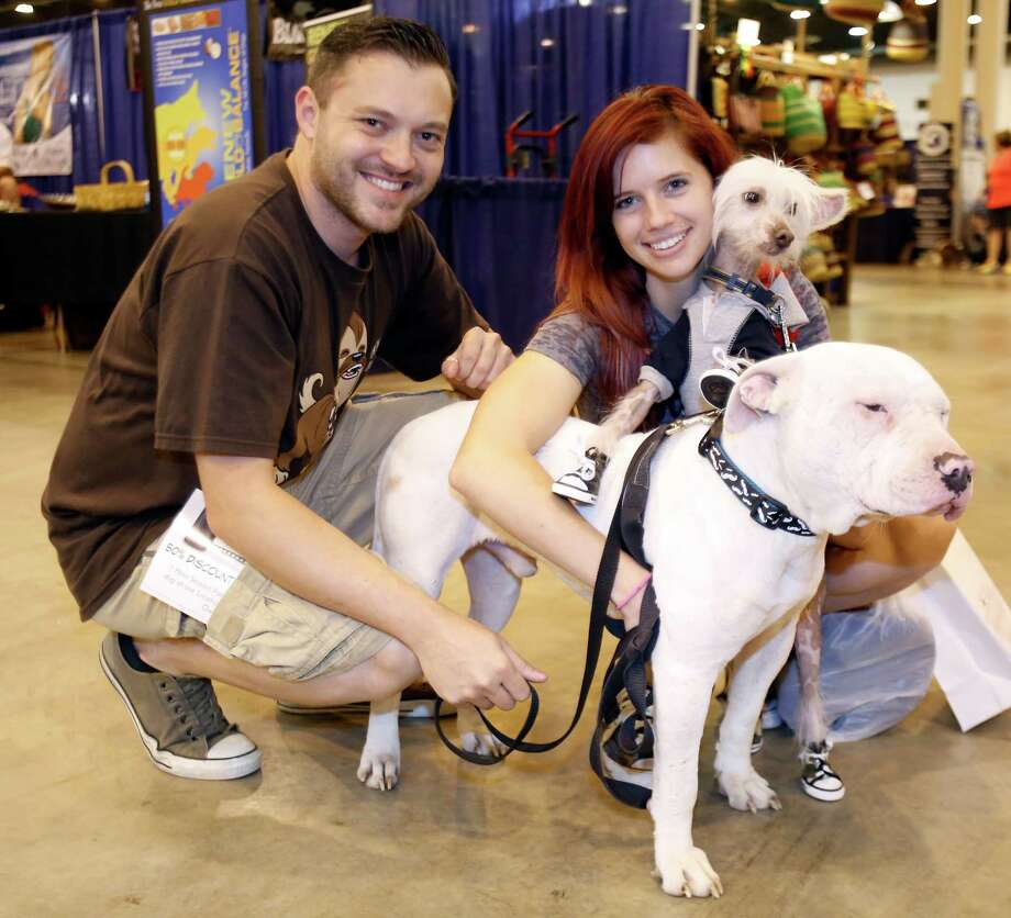 People pose with their dogs during the Houston World Series of Dog Shows at NRG Center Sunday, July 20, 2014, in Houston. Photo: Melissa Phillip, Houston Chronicle / © 2014  Houston Chronicle