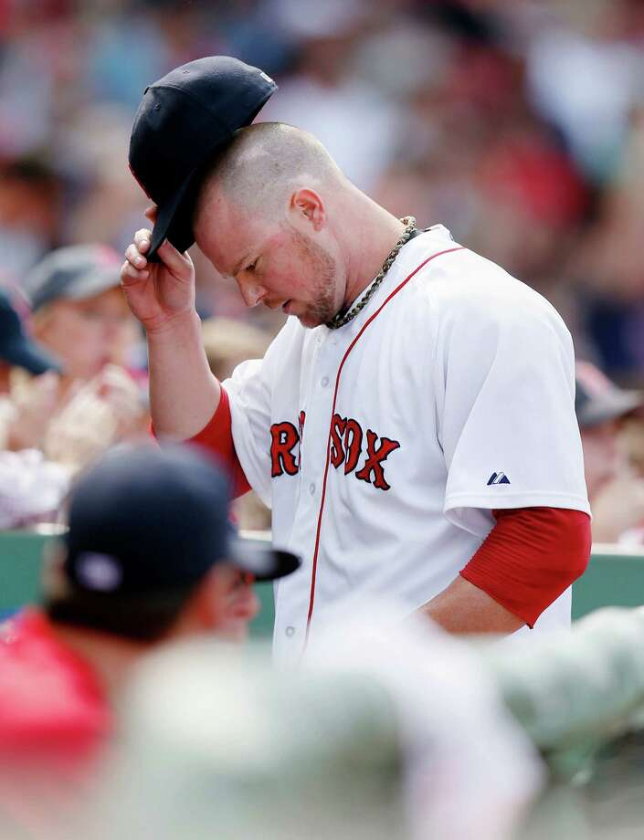 Boston Red Sox's Jon Lester enters the dug out after pitching in the seventh inning of a baseball game against the Kansas City Royals in Boston, Sunday, July 20, 2014. The Red Sox won 6-0. (AP Photo/Michael Dwyer) ORG XMIT: MAMD111 Photo: Michael Dwyer / AP