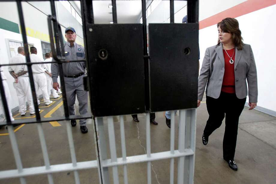 Warden Tracy Bailey walks through the gates that keep inmates contained at the Texas Department of Criminal Justice's Estelle Unit in Huntsville on Wednesday. Photo: Mayra Beltran, Staff / © 2014 Houston Chronicle