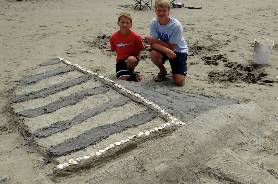 Borthers Will and Nick Mears, of Fairfield, sculpted a sailboat Sunday at the Fairfield PAL contest. Photo: Mike Lauterborn / Fairfield Citizen