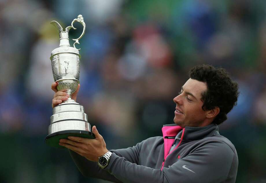 Rory McIlroy of Northern Ireland holds up the Claret Jug trophy after winning the British Open Golf championship at the Royal Liverpool golf club, Hoylake, England, Sunday July 20, 2014. (AP Photo/Scott Heppell) ORG XMIT: HOY368 Photo: Scott Heppell / AP