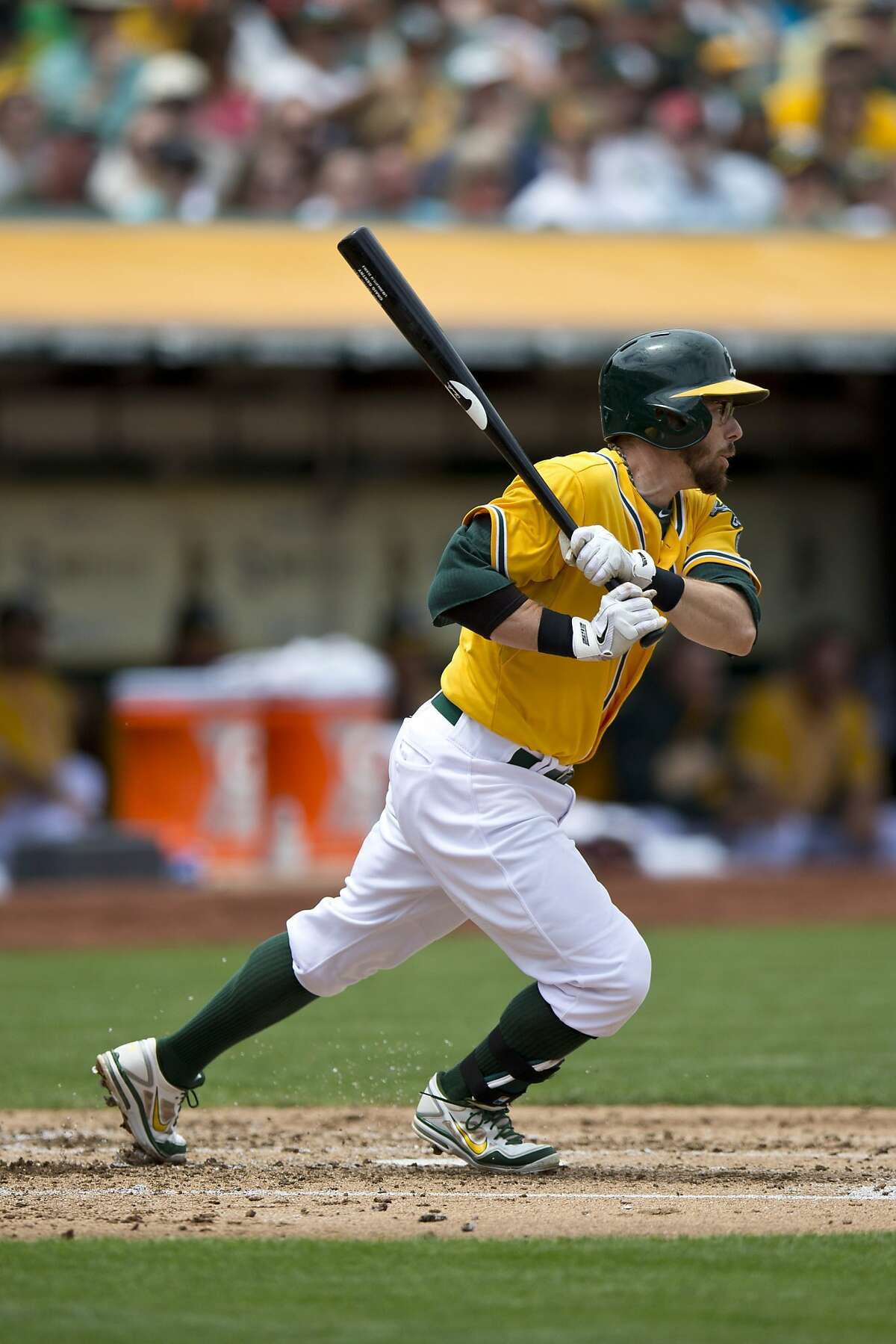 OAKLAND, CA - JULY 20: Eric Sogard #28 of the Oakland Athletics hits a single against the Baltimore Orioles during the second inning at O.co Coliseum on July 20, 2014 in Oakland, California. The Oakland Athletics defeated the Baltimore Orioles 10-2. (Photo by Jason O. Watson/Getty Images)
