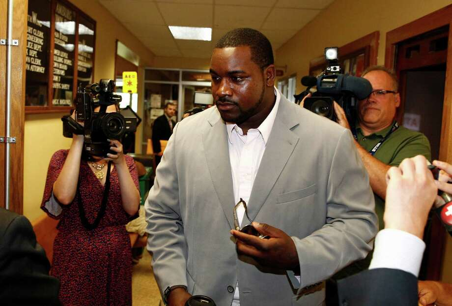 Buffalo Bills NFL football player Marcell Dareus arrives at Hamburg Town Court, in Hamburg, N.Y., Tuesday, July 1, 2014. Dareus was scheduled to appear regarding reckless driving charges stemming from an alleged street-racing accident which the player crashed his 2012 Jaguar into a tree. (AP Photo/The Buffalo News, John Hickey) TV OUT; MAGS OUT; SALAMANCA PRESS OUT; TONAWANDA NEWS OUT ORG XMIT: NYBUE101 Photo: John Hickey / The Buffalo News
