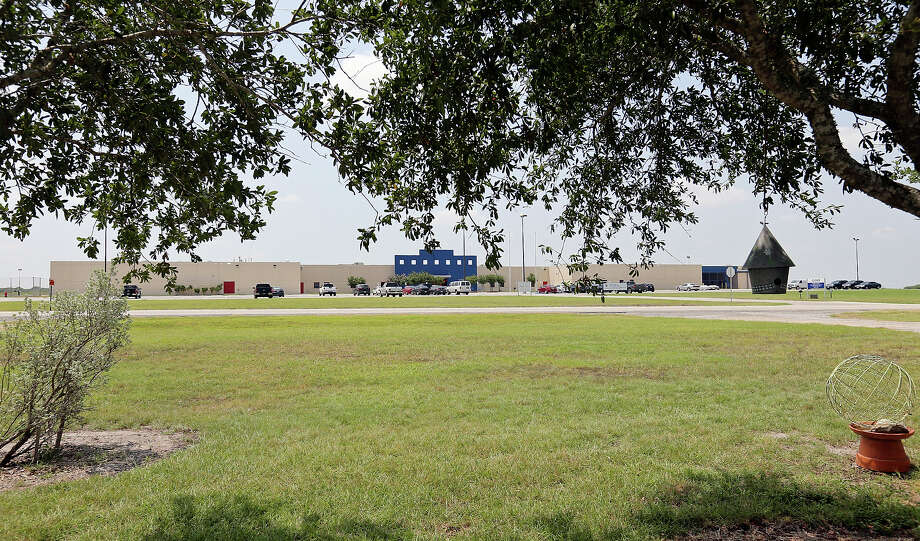 A view of the Karnes County Civil Detention Center, Sunday July 20, 2014 in Karnes City, Tx., where undocumented women and children from Central America  are scheduled to be housed from the front yard of a home across the street. Photo: Edward A. Ornelas, San Antonio Express-News / © 2014 San Antonio Express-News