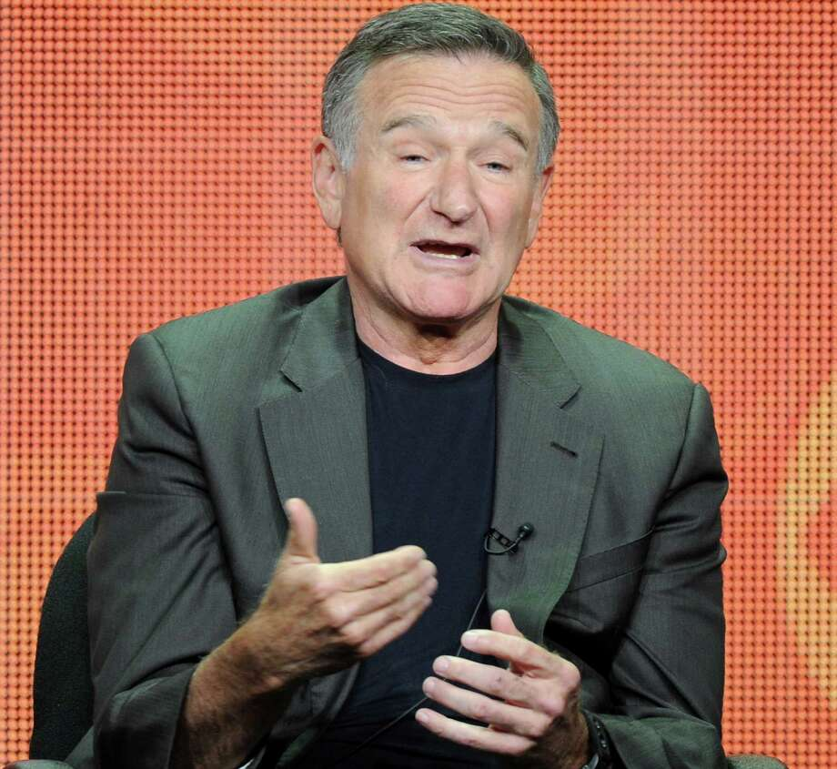 "FILE - In this July 29, 2013 file photo, actor Robin Williams participates in the ""The Crazy Ones"" panel at the 2013 CBS Summer TCA Press Tour at the Beverly Hilton Hotel in Beverly Hills, Calif. Williams is reconnecting with the 12-step program during a brief stay in Minnesota. A spokeswoman for the 62-year-old actor-comedian said on Tuesday, July 1, 2014, that Williams planned the visit as a respite to recharge after more than 18 straight months of work.  (Photo by Frank Micelotta/Invision/AP, File) ORG XMIT: CAET175 Photo: Frank Micelotta / Invision"