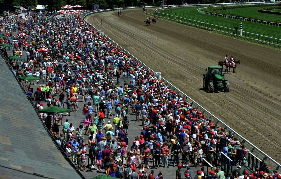 There is a sea of red hats on giveaway day July 20, 2014 at the Saratoga Race Course in Saratoga Springs, N.Y.      (Skip Dickstein / Times Union) Photo: SKIP DICKSTEIN