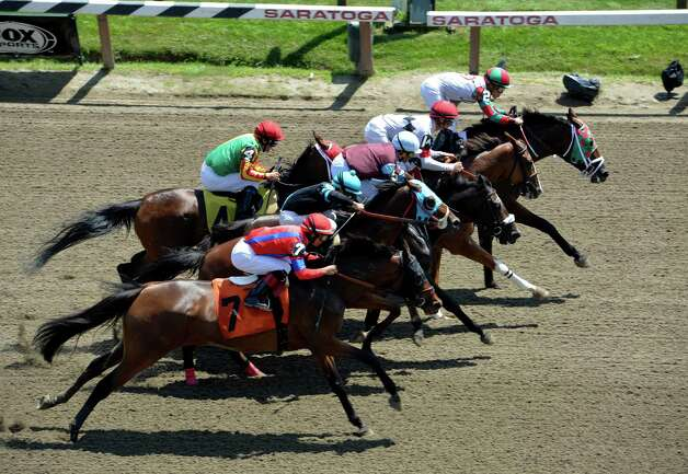 Horses charge down the stretch at the start of the second race on the card Sunday afternoon July 20, 2014 at the Saratoga Race Course in Saratoga Springs, N.Y.      (Skip Dickstein / Times Union) Photo: SKIP DICKSTEIN