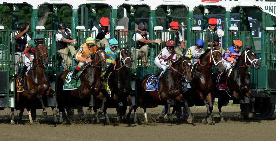 Stopchargingmaria with jockey Javier Castellano leaves the starting gate from the #1 position far right to win the 98th running of the Coaching Club American Oaks Sunday evening July 20, 2014 at the Saratoga Race Course in Saratoga Springs, N.Y.       (Skip Dickstein / Times Union) Photo: SKIP DICKSTEIN