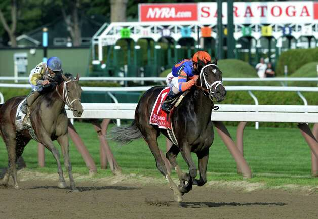 Stopchargingmaria with jockey Javier Castellano outpaces the field to win the 98th running of the Coaching Club American Oaks Sunday evening July 20, 2014 at the Saratoga Race Course in Saratoga Springs, N.Y.       (Skip Dickstein / Times Union) Photo: SKIP DICKSTEIN
