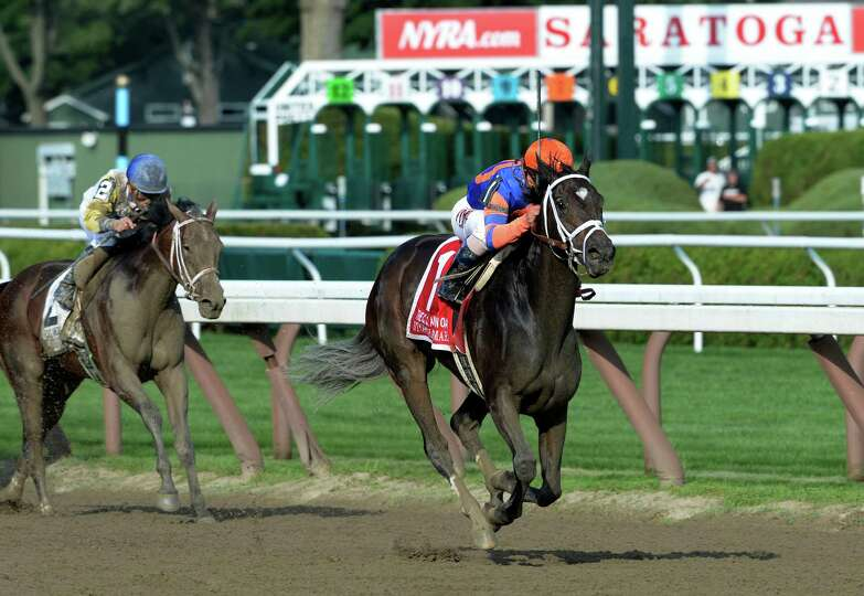 Stopchargingmaria with jockey Javier Castellano outpaces the field to win the 98th running of the Co