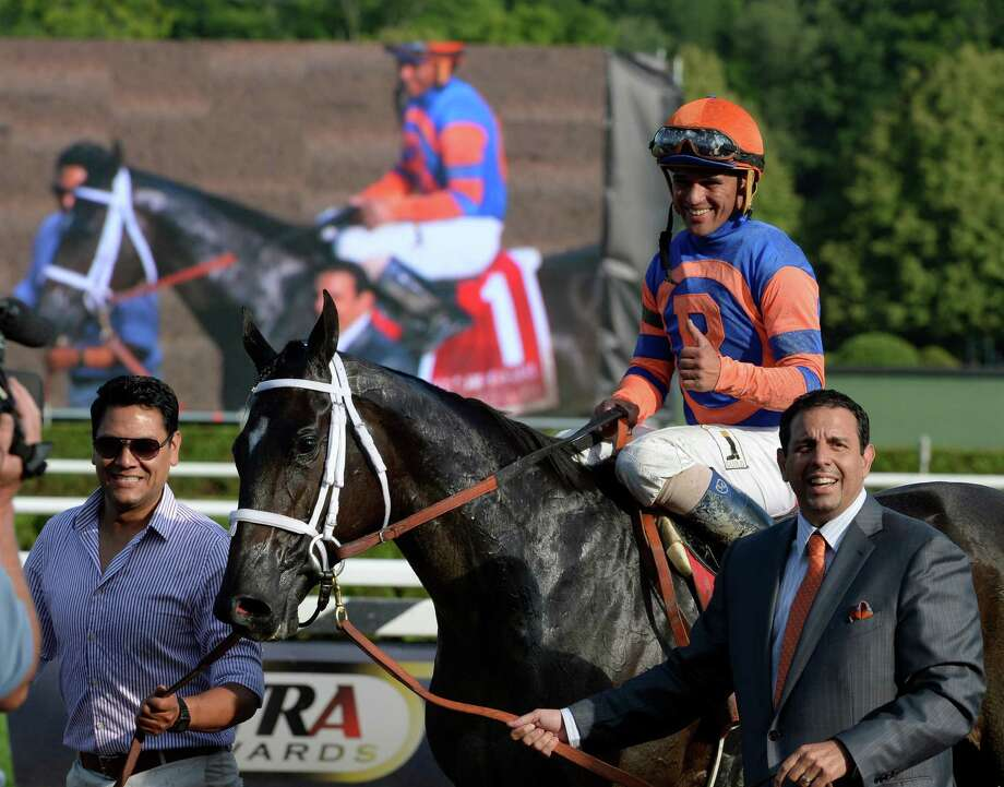 Stopchargingmaria with jockey Javier Castellano is lead to the winner's circle by owner Michael Repole after winning the 98th running of the Coaching Club American Oaks Sunday evening July 20, 2014 at the Saratoga Race Course in Saratoga Springs, N.Y.       (Skip Dickstein / Times Union) Photo: SKIP DICKSTEIN