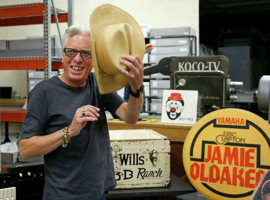 Musician Jamie Oldaker  holds a hat that once belonged to Western swing musician Bob Wills at the Oklahoma History Center in Oklahoma City. Photo: Sue Ogrocki, STF / AP