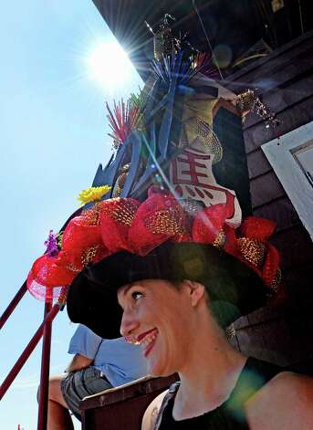 One of the entrants for the annual hat contest is all smiles as she waits for judging to begin Sunday afternoon July 20, 2014 at the Saratoga Race Course in Saratoga Springs, N.Y.       (Skip Dickstein / Times Union) Photo: SKIP DICKSTEIN
