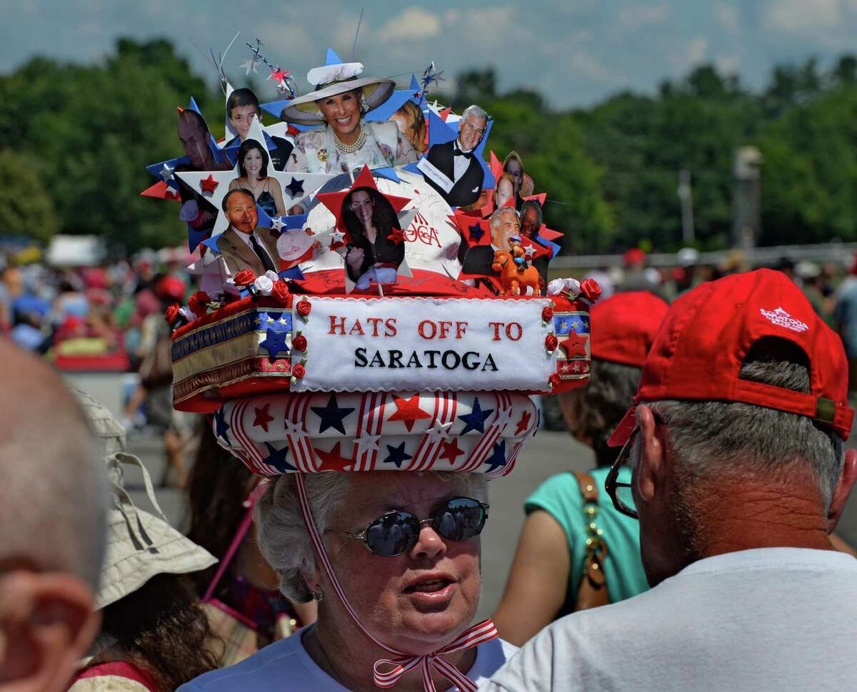 Former hat contest winner Kathleen Christopher shows off her celebrity hat before the judging took place Sunday afternoon July 20, 2014 at the Saratoga Race Course in Saratoga Springs, N.Y. (Skip Dickstein / Times Union)